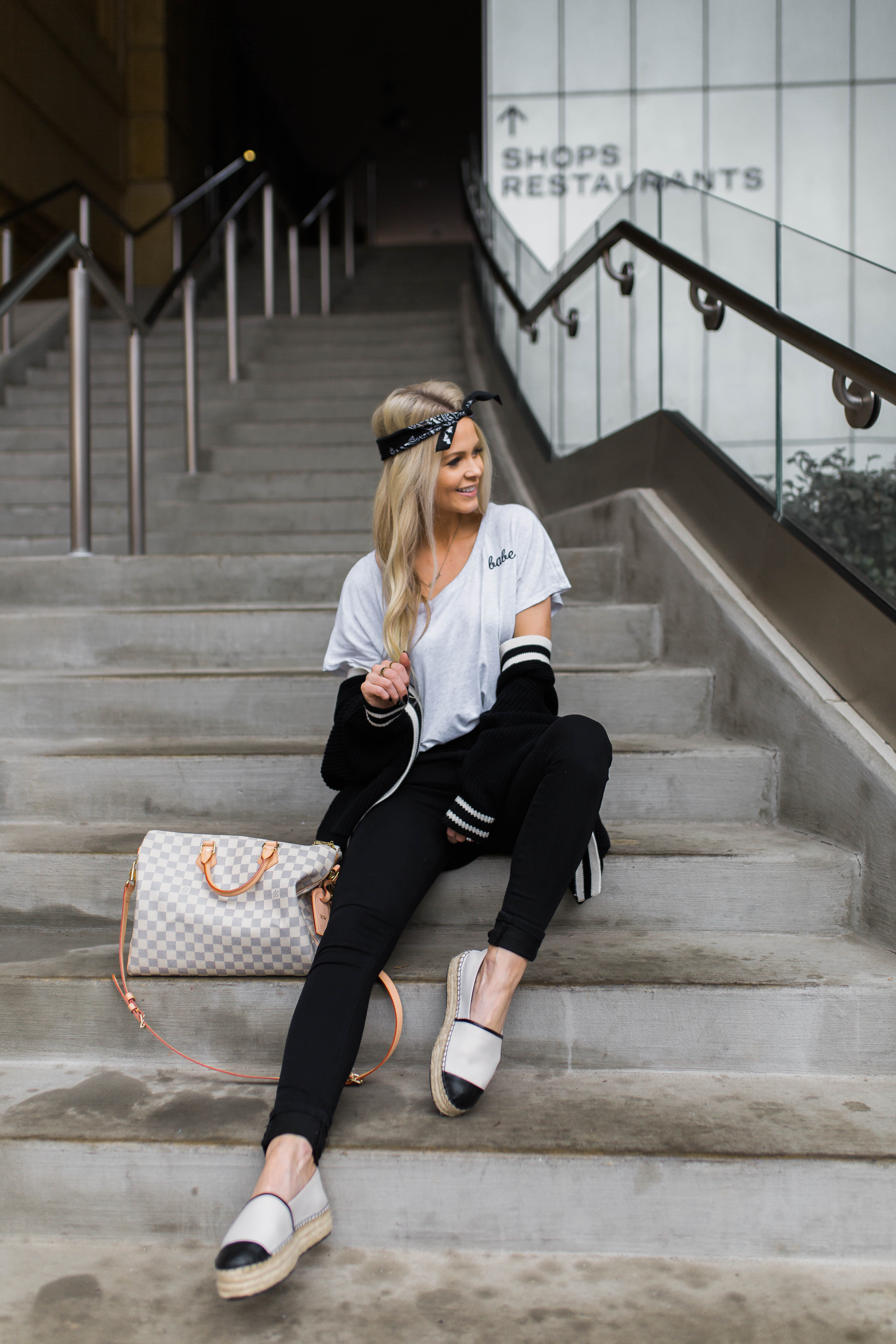 blogger on stairs pose