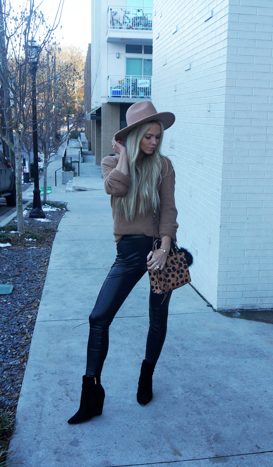 camel sweater, leather leggings