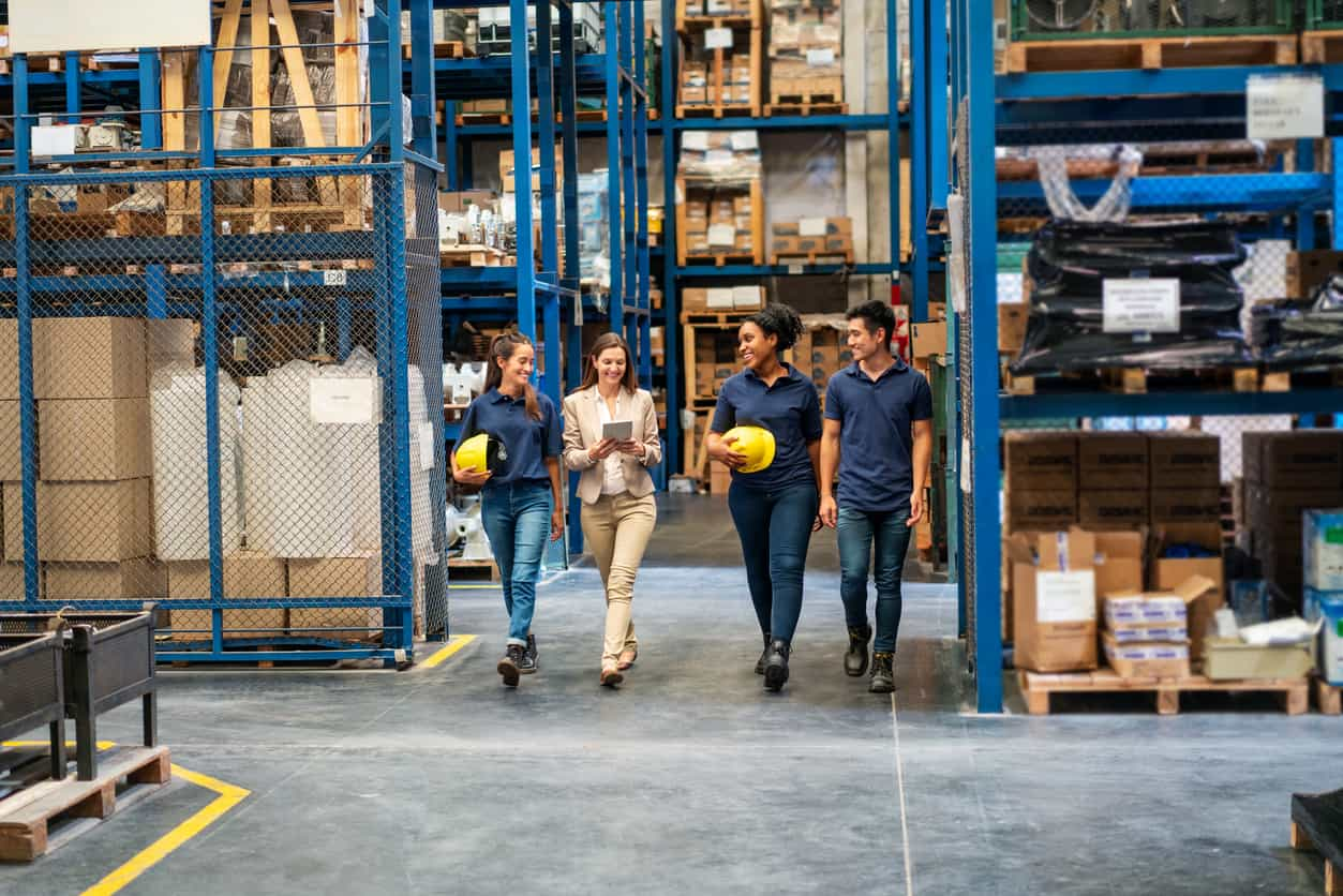 Distribution warehouse employees walking in plant