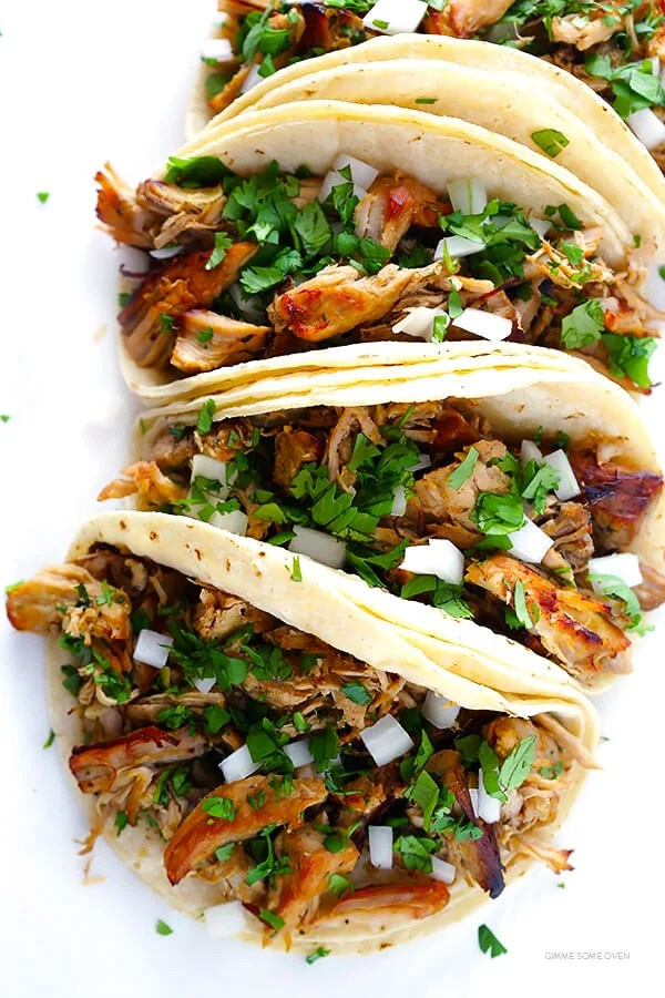 Crispy Slow Cooker Carnitas -- This favorite Mexican pork recipe is easy to make in the crock pot (then crisped up for a few minutes in the oven), and it's perfectly tender, juicy and crispy. Awesome on tacos, burritos, salads, you name it! | gimmesomeoven.com