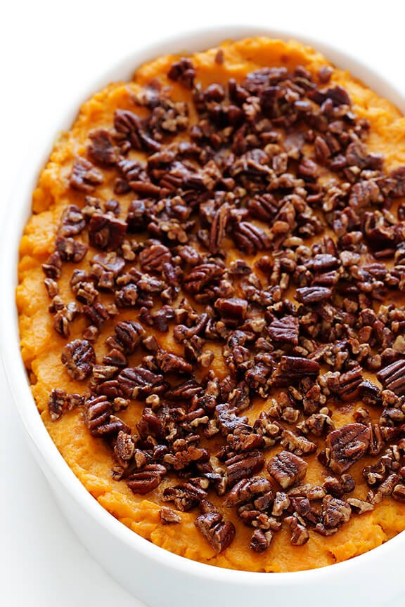 Healthier Sweet Potato Casserole -- naturally sweetened with a hint of maple syrup, and topped with cinnamon pecans | gimmesomeoven.com
