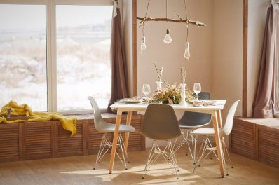 mid-century modern dining area in front of window