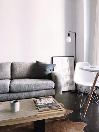 grey couch in white interior Scandinavian design