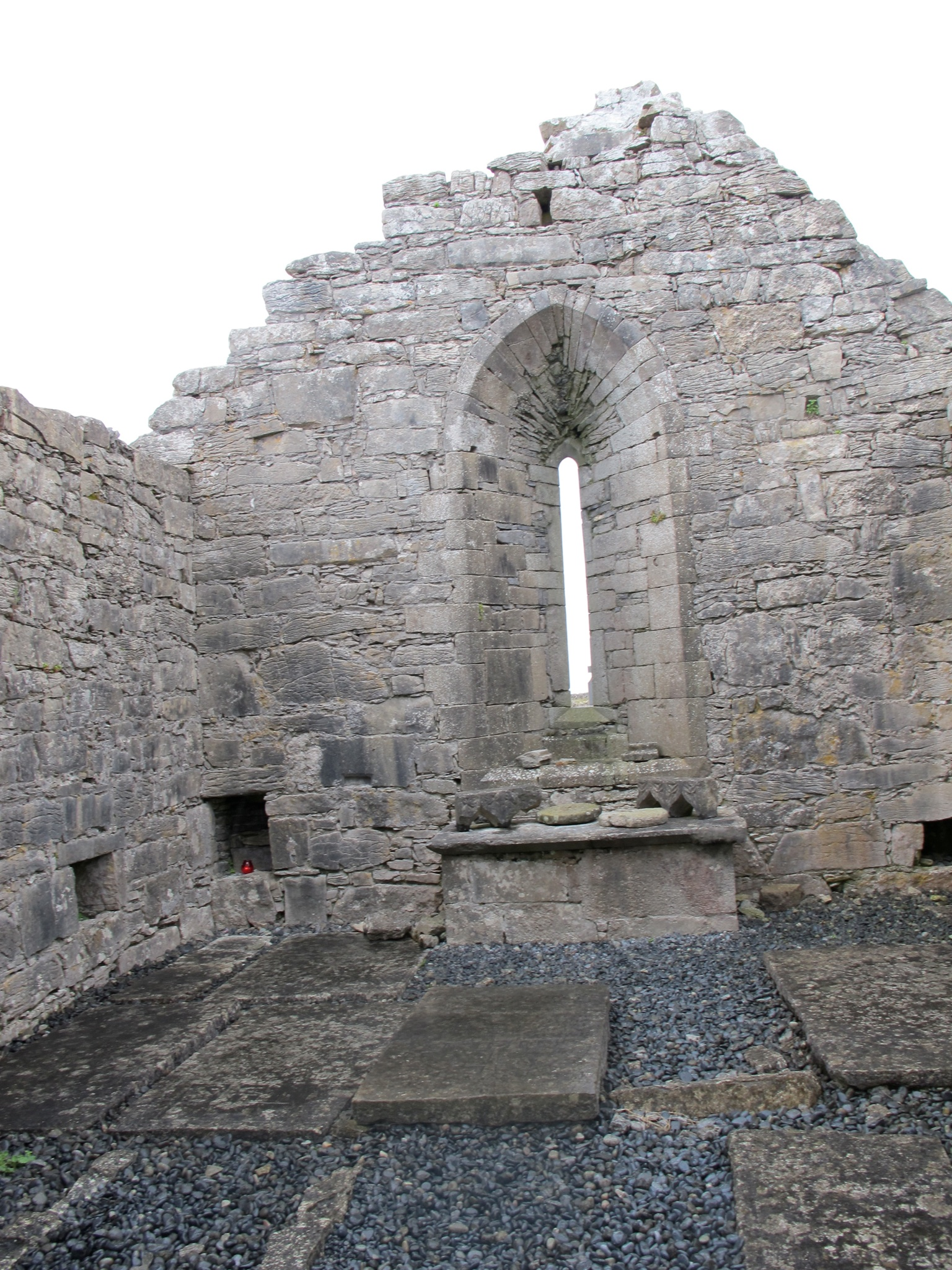 The inside of Teampull Bheanáin, you can see what is believed to be a shrine to beloved St. Patrick.