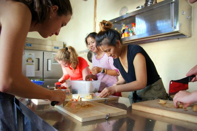 American students preparing lunch in the temple kitchen - Shaxi Yunnan China