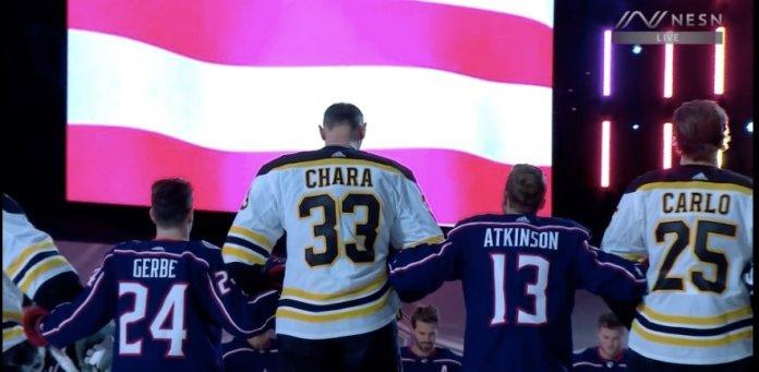 Zdeno Chara stands between Nathan Gerbe and Cam Atkinson
