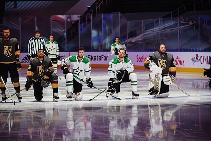 Tyler Seguin, Jason Dickinson, Ryan Reaves and Robin Lehner all take a knee during the National Anthems