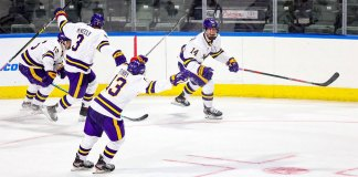 The Minnesota State Mavericks hockey team celebrates a goal