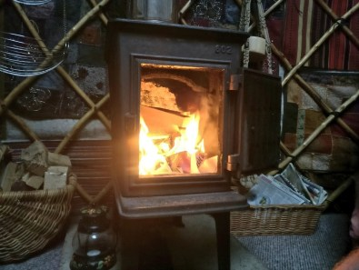 glamping in a yurt log burner