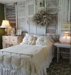 Rustic setting for bedroom with old shutters on the walls