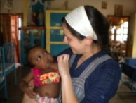 I volunteered at the Missionaries of Charity in Calcutta (Kolkata) India. I was working at an orphanage for disabled children, and the boy I'm holding's name is Roshan. While I was there I volunteered at the orphanage in the mornings and at a hospice in Kalighat in the afternoons. This is where I was able to witness the brothel mentioned in Half the Sky.