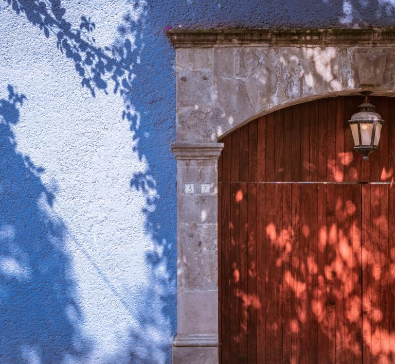 A red door of a blue house in Mexico City. Femicides increase in Mexico