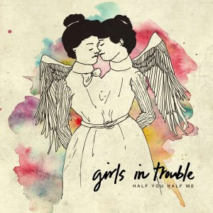 "image of cover of ""Half You Half Me"" album- Girls in Trouble logo and album name on artwork of two winged women connected at the waist, heads nuzzling against each other"