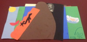 construction paper collage of Abraham leading Isaac to Moriah, Sarah's face hiding behind, and God's lips