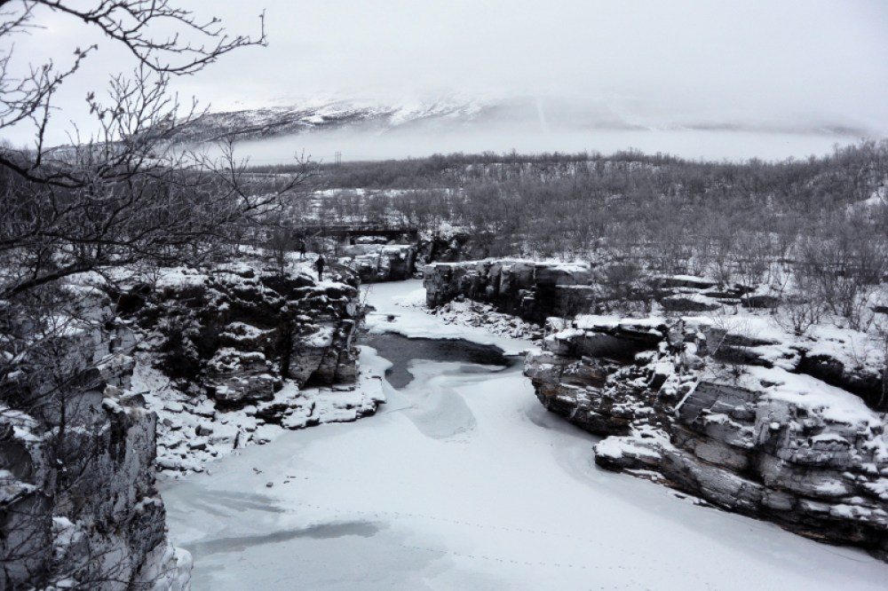 view of glaciers and rocks in snow, abisko, sweden