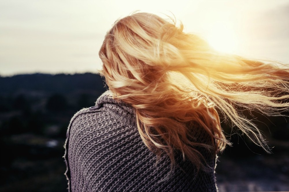 Dealing with anxiety - blonde girl looking into sunset