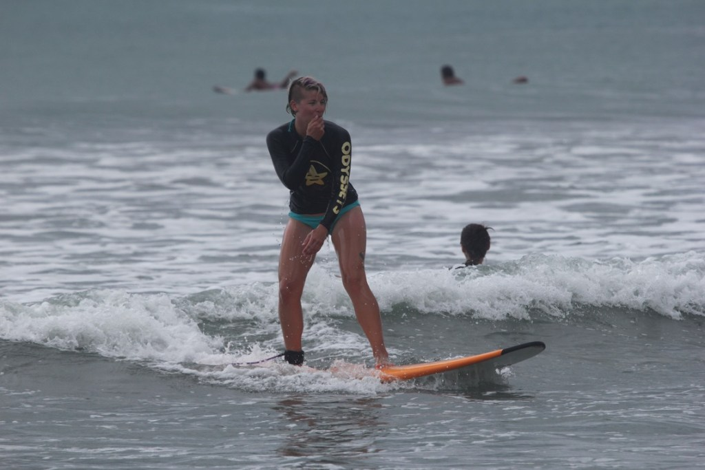Girl Surfing in Bali, healthy fit travelling