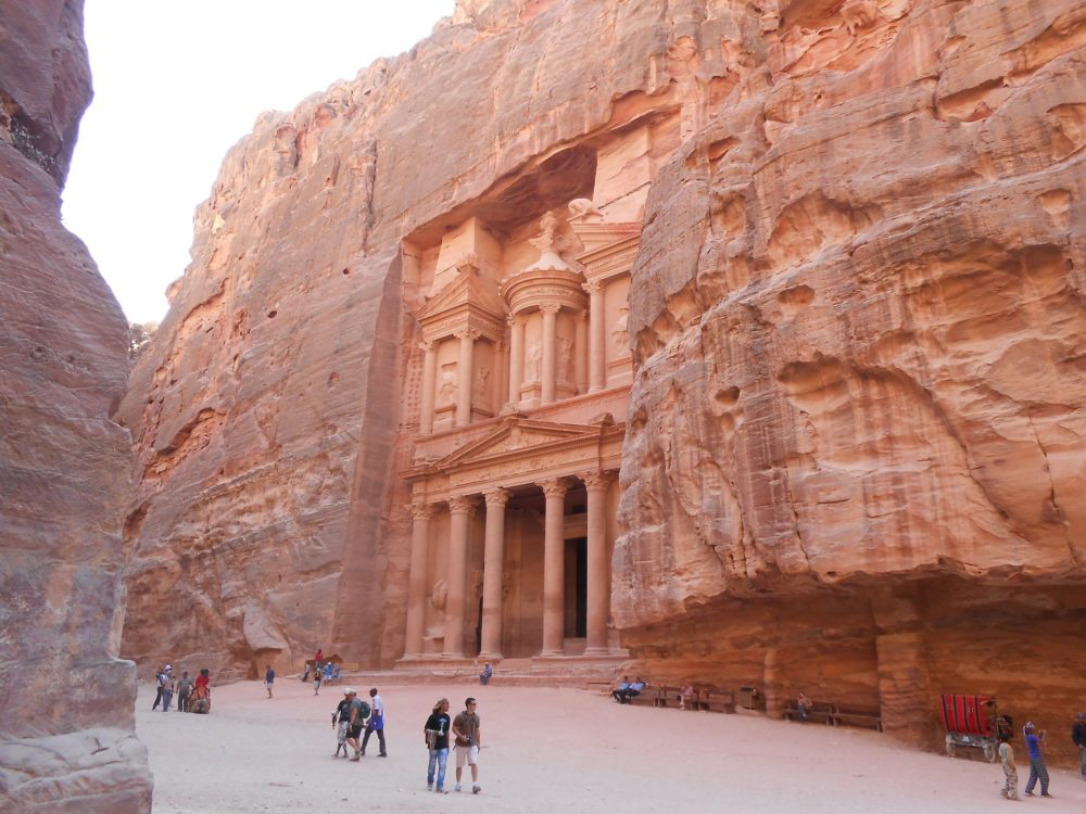 tourist standing in front of treasury at Petra, Jordan