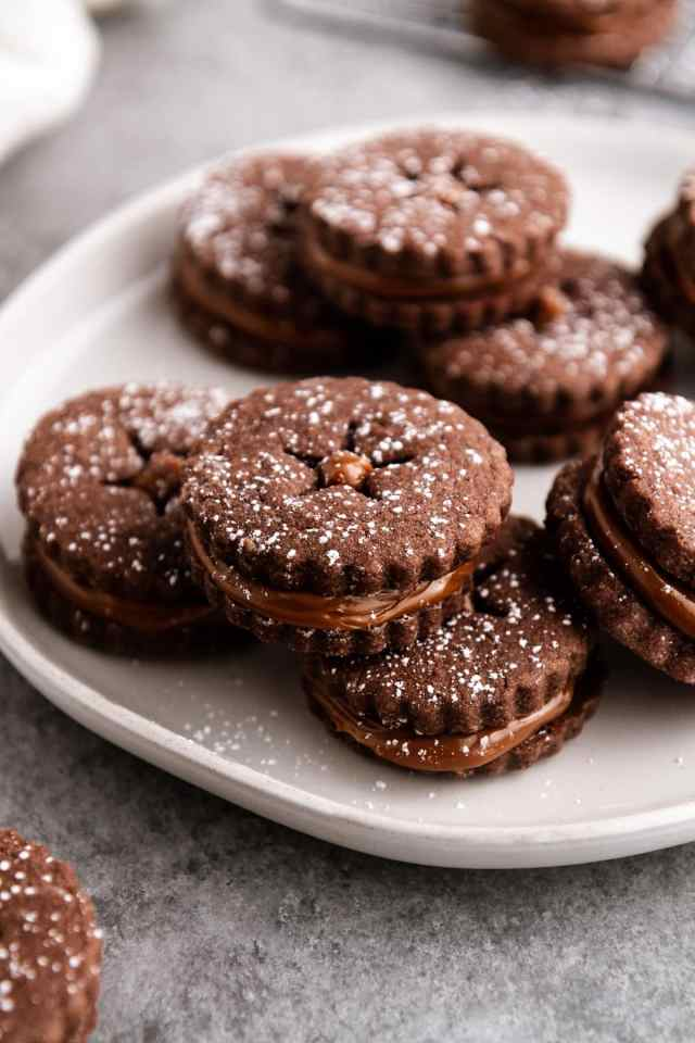 chocolate alfajores stacked on a plate