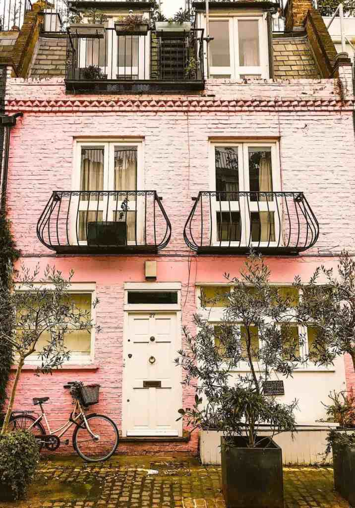 The ethereal charm of the infamous pink house on St. Lukes Mews in Notting Hill.
