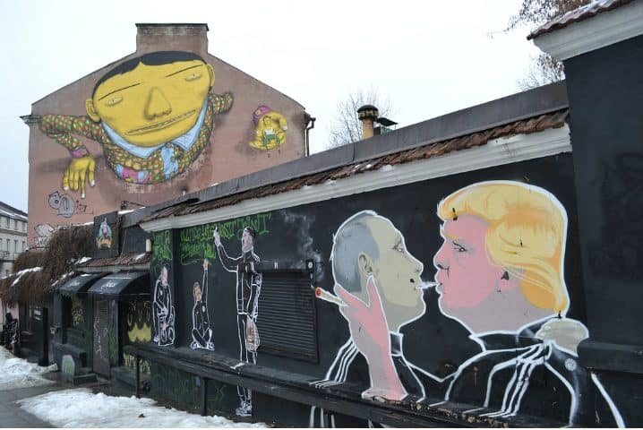 Not sure what to do in Vilnius? Then check out some of the city's iconic street art, like this immortal mural of Putin and Trump.