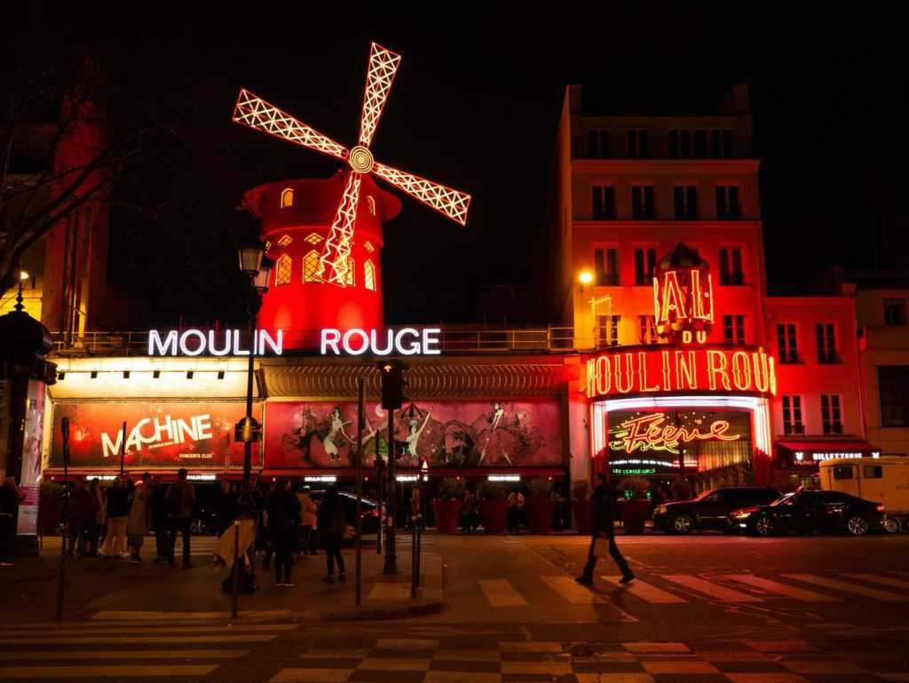 The world famous red windmill that is now synonymous with the most iconic cabaret in all of Paris, the Moulin Rouge.