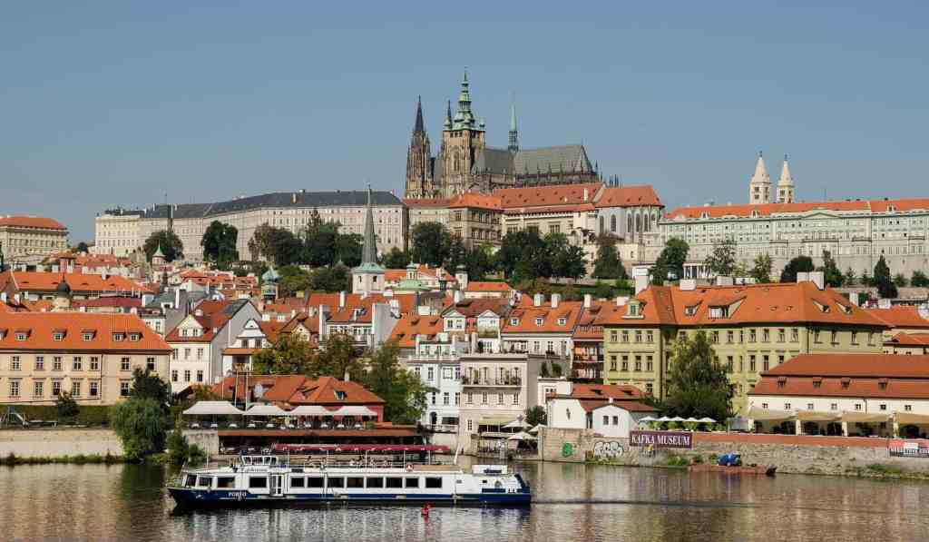 A scenic view of Prague from the Vltava River.
