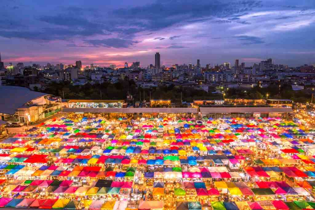 The vibrant glow of the massive, Chatuchak Weekend Market in Bangkok.