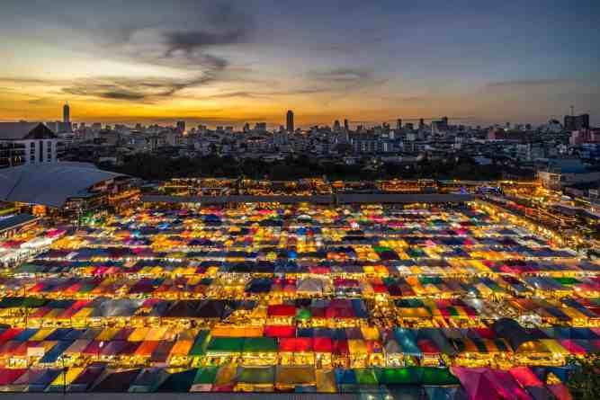 The colorful glow of Rot Fai Night Market in Srinakarin, Bangkok.
