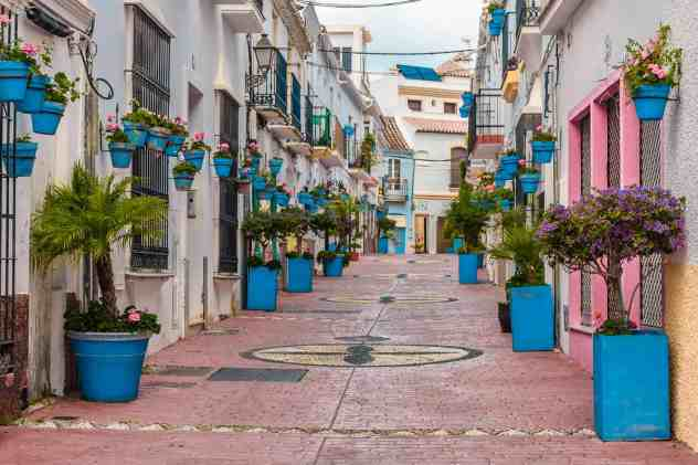 The enchanting, flower pot lined streets of Estepona, Spain.