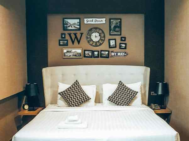 The fun decor and comfy accommodations that you'll find at The Printing House Poshtel, one of the best places to stay in Bangkok.