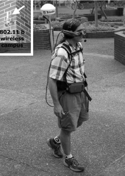 A user taking the Drishti prototype on a test run. A roughly 8 pound backpack contains the GPS receiver and electronic compass. The user wears the head mounted display for visual tracking (disabled) and the integrated headset for speech I/O (blind). Image: Helal, Moore, and Ramachandran, 2001.