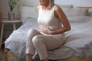 lady hold belly suffer from abdomen ache