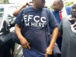 OMG! Former Governor of Ekiti State, Ayo FAYOSE Rocks 'EFCC I'M HERE!' Shirt to EFCC's Office