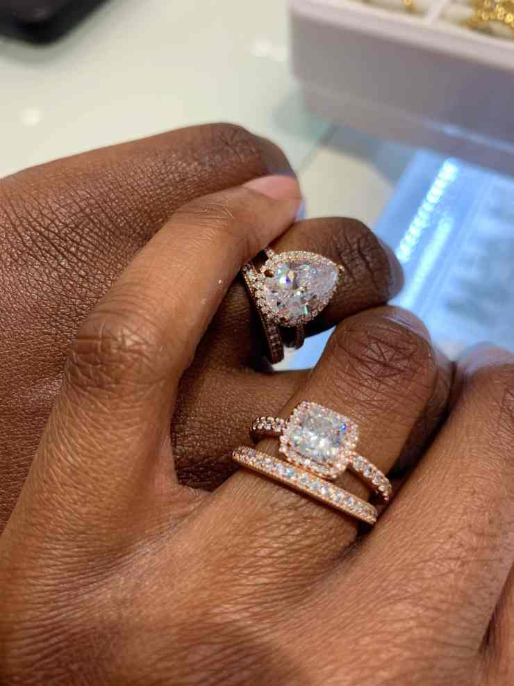 Two ladies show off their rings to announce their engagement to each other 3