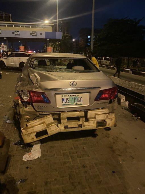 Cars destroyed as PHCN truck rams into #EndSARS protesters at Lekki Toll Gate this morning (Photos/Videos)
