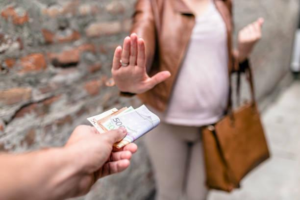 woman rejecting money