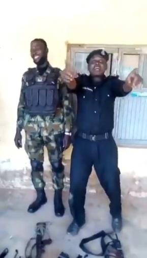 Police Officer becomes laughing stock after struggling to assemble gun while competing with Soldier (Video)
