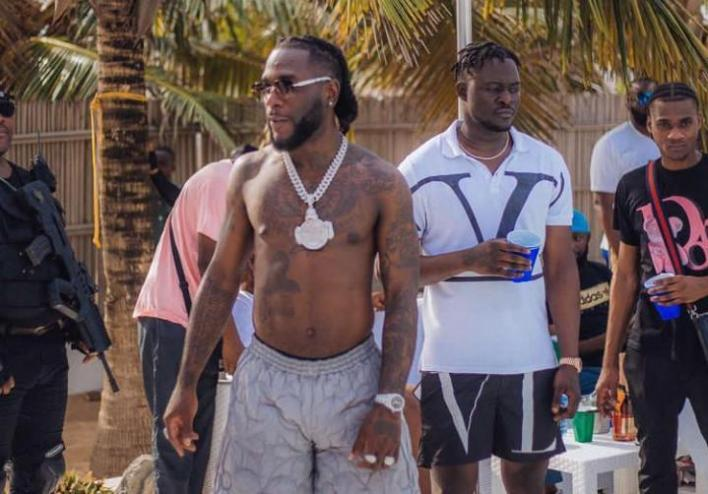 Burna Boy reacts after a mechanic called him out