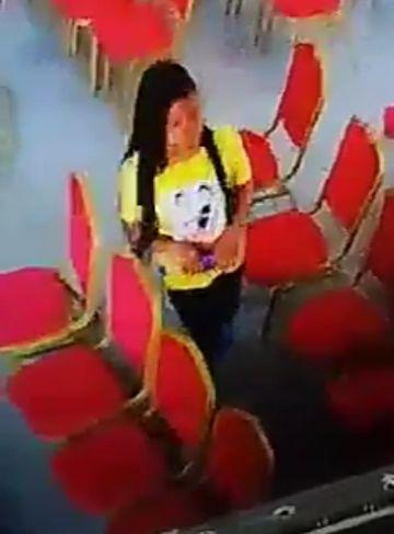 Lady caught on camera stealing a phone inside a church in Warri (Video)