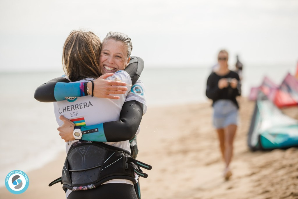 The finalists embrace off the water
