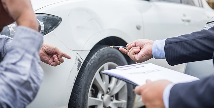 Car Insurance Attorney pointing at car