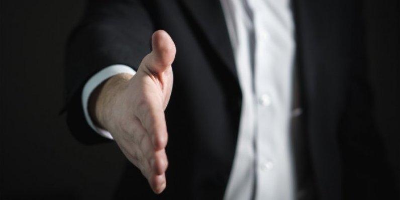 businessman-offering-handshake-to-seal-deal