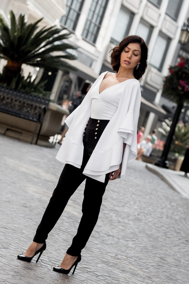 Fashion blogger wearing Karla Garzaro body suit with ruffles and high waisted pants