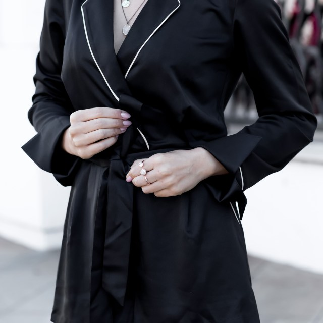 Fashion blogger wearing pajama trend satin black romper
