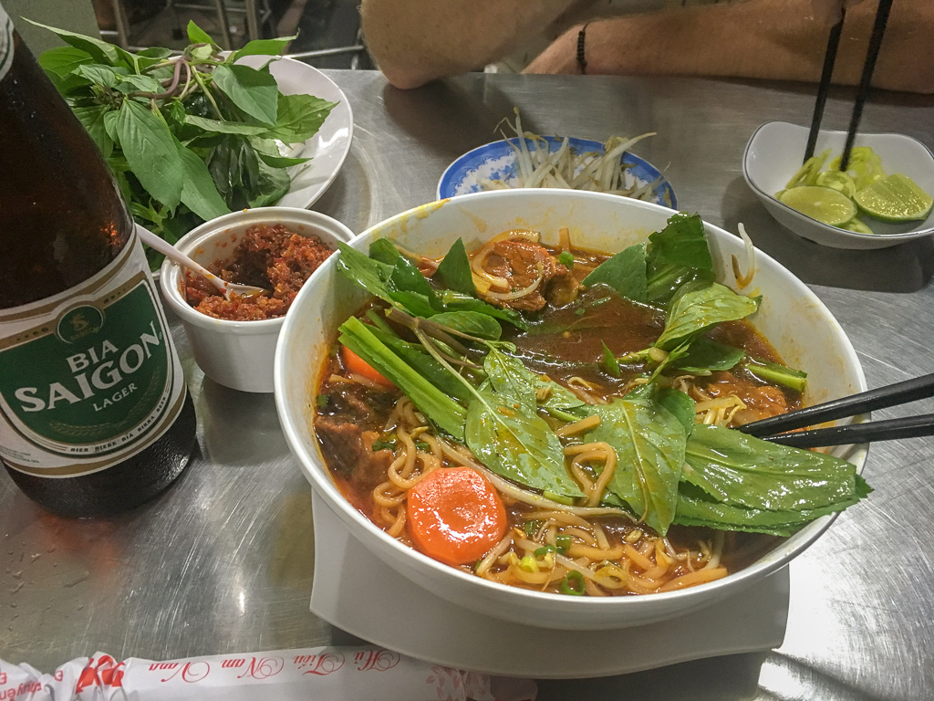 A typical backpacker dinner of Pho and Bia Saigon (Vietnamese beer)