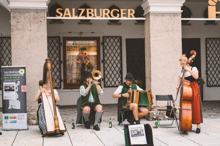 Mozartplatz performers playing their instruments