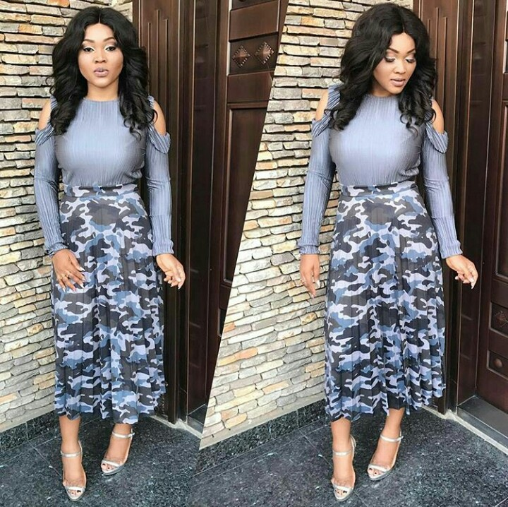 Mercy Aigbe in Camo skirt and cold shoulder top