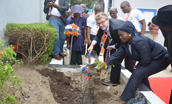 The Managing Director, Promasidor Nigeria, Mr Olivier Thiry, ably assisted by Mrs. Adetola Wosilat Onisarotu, a Director in Lagos State Environmental Protection Agency (LASEPA) planting a tree in the premises of Promasidor.