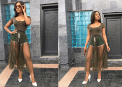 In The Spirit Of Independence, Toni Tones Steps Out In Sheer Green Skirt